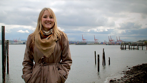 Elise Hunt standing on the waterfront in Seattle